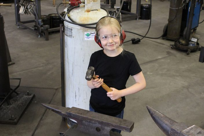 Maddy in metal fabrication shop
